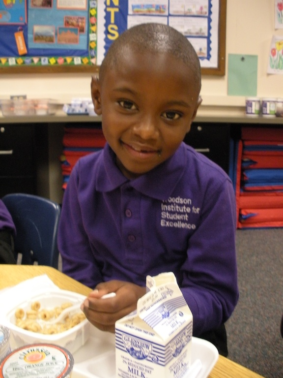 Erza enjoys breakfast in the classroom, Minneapolis, MN