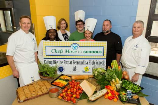 (Left to right) Thomas Tolxdorf, executive chef of The Ritz Carlton, Amelia Island, Amari Forrest, Fernandina Beach High School (FBHS) student, Allyn Graves, director of school food service of Nassau County School Board, Bishop Richards, FBHS student, Laura Perkins, FBHS student, Michael Gass, chef and culinary teacher at FBHS and Glenn Wright, chef at The Ritz Carlton, Amelia Island.