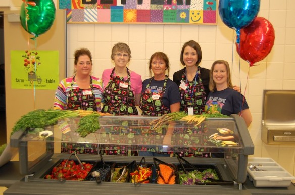 "In Lake Stevens, Washington, their ""Build a Rainbow"" Salad Bar is served with many smiles."