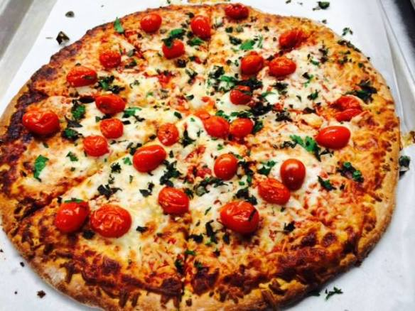 House-made pizza with local tomatoes and basil from the Oyster River (NH) school garden